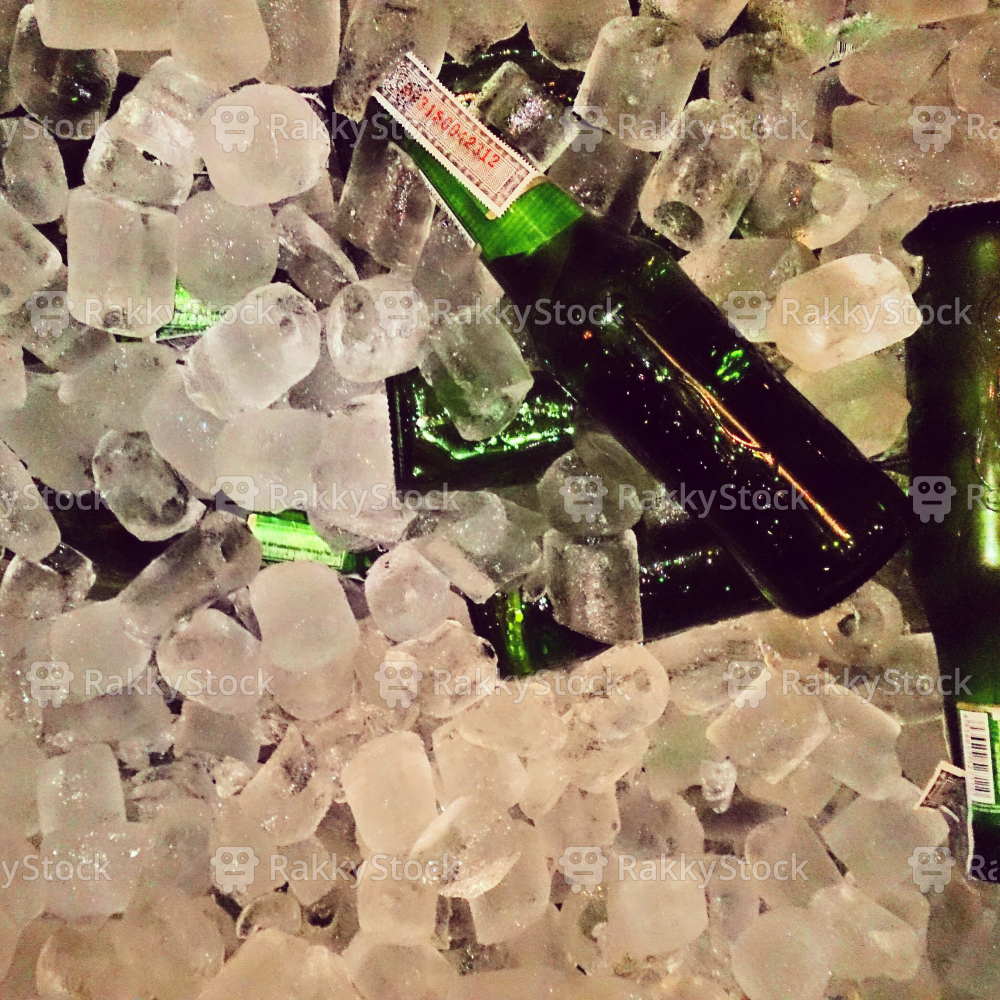 Beer bottle on ice